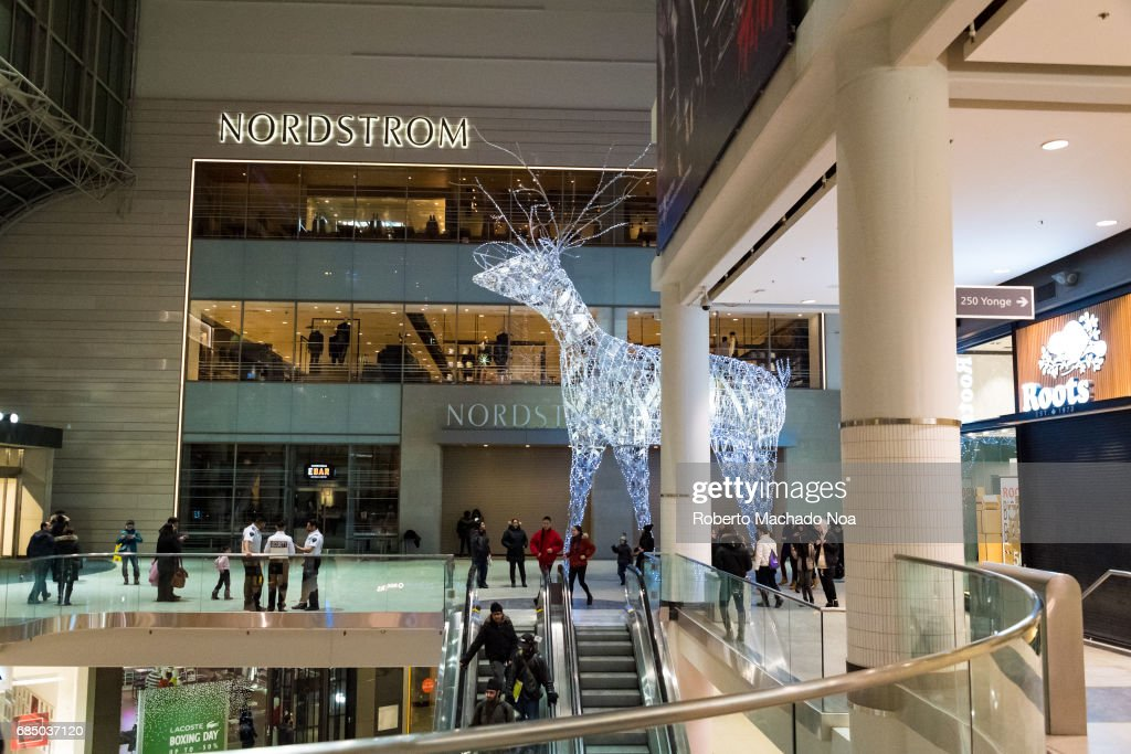 giant lit up reindeer standing outside nordstrom store in the eaton center christmas decorations and