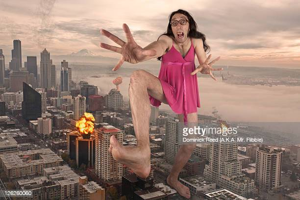 giant man in pink dress destroying city - comparison stock pictures, royalty-free photos & images