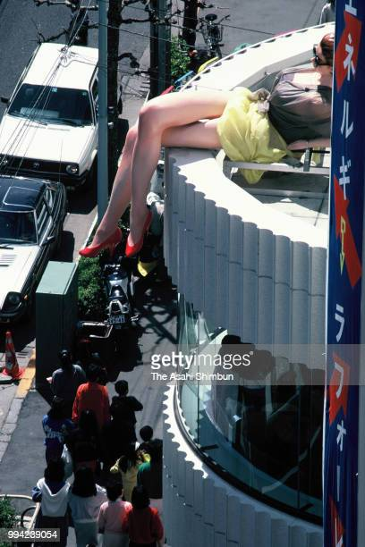 Giant mannequin is displayed on buildings on April 10, 1986 in Tokyo, Japan.