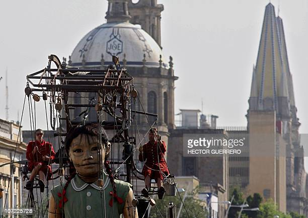 A giant marionette called 'Little Giant' of the French street theater company Royal de Luxe performs in Guadalajara Mexico on November 26 in the...