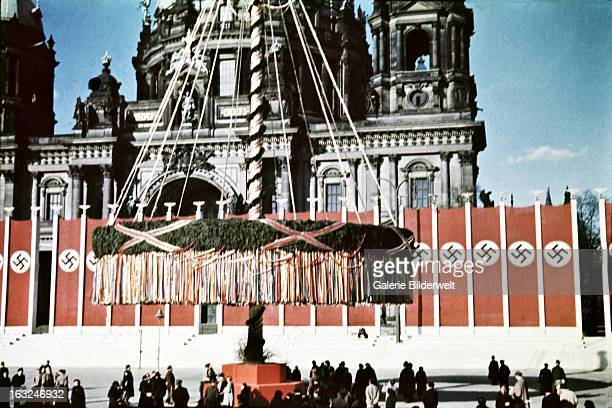 A giant maypole and swastika flags in front of the Dome next to the Lustgarten where Adolf Hitler chancellor of Germany delivered a speech in front...