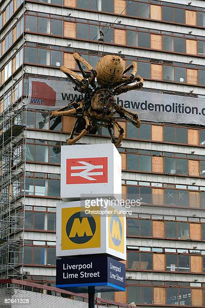 A giant mechanical spider sits on the side of the derelict Concourse tower in Liverpool city centre on 3 September Liverpool England The 50ft tall...