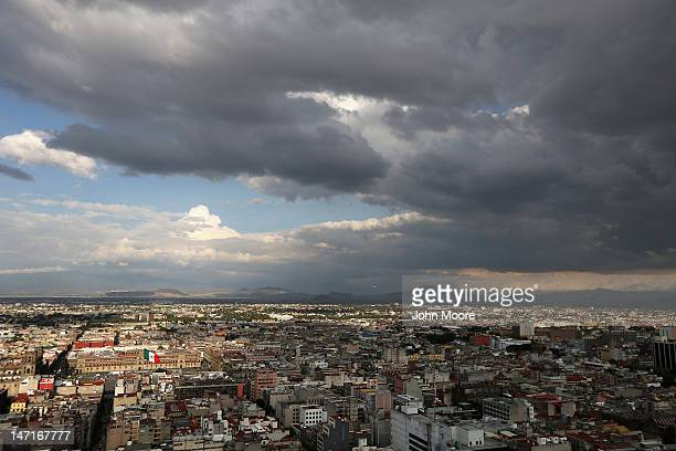 A giant Mexican tricolor flag blows over the city's main zocalo plaza on June 26 2012 in Mexico City Mexico Mexicans go to the polls to elect a new...