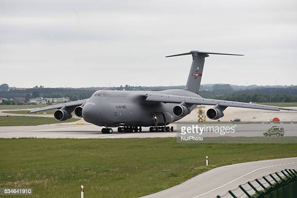 Giant military cargo aircraft Lockheed C5 Galaxy takes off Gdansk Lech Walesa airport on May 26 2016 Group of US Soldiers with 7 vehicles Humvee type...