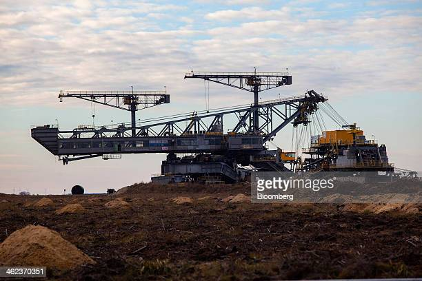 A giant mining conveyor machine stands at a openpit lignite mine operated by Vattenfall AB in WelzowSued Germany on Saturday Jan 11 2014 Across the...