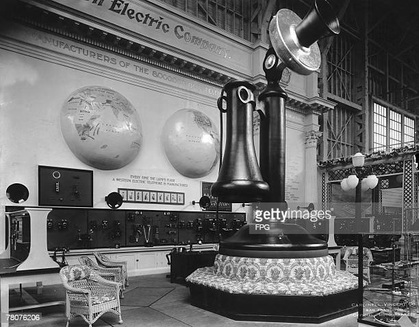 A giant model of a candlestick telephone incorporating a sofa at its base is the centrepiece of the Western Electric stand in the Palace of Liberal...