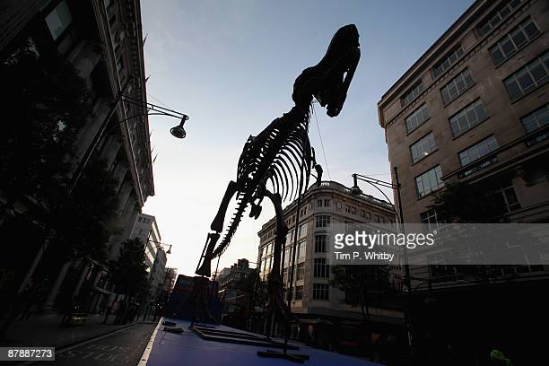 A giant model Tyrannosaurus Rex as featured in 'Night of the Museum 2' tours Oxford Street in advance of his appearance during the upcoming May Bank...