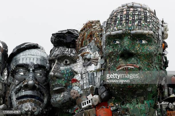 Giant Mount Rushmore-style sculpture of the G7 leaders heads, made entirely of discarded electronics, is displayed on a beach near to Carbis Bay,...