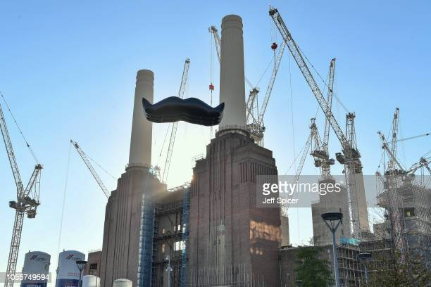 A giant moustache is hung at Battersea Power Station as Movember launches the 2018 campaign to get men focusing on their health with moustaches...