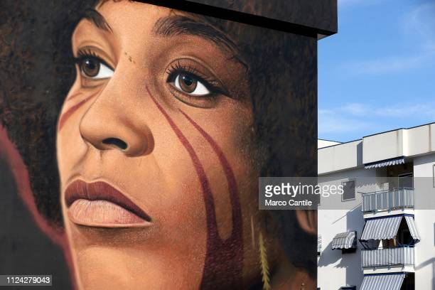 A giant mural by the street artist Jorit Agoch depicting Angela Davis in the Scampia district of Naples