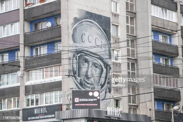 Giant mural with Alexei Leonov portrait wearing space helmet is seen in Kaliningrad Russia on 8 September 2019 Leonov is the first man to walk in...