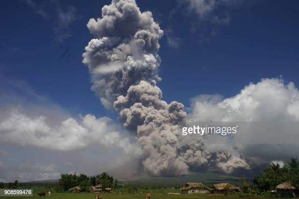 TOPSHOT A giant mushroomshaped cloud rises into the air from the Mayon volcano seen from the highway in the town of Camalig near Legazpi City in...