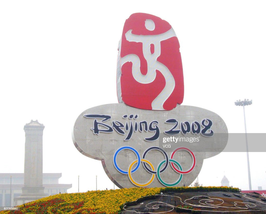 A giant neon Beijing 2008 Olympic Games symbol with olympic rings forms the centrepiece of a parterre at Tiananmen Square, completed on July 28, 2008 in Beijing, China. The formal garden will remain on display nearly three months; throughout the Olympic Games, the Paralympic Games and China's National Day. The last parterre to be set up at Tiananmen Square was in 1986.
