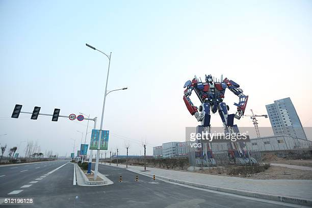 A giant 'Optimus Prime' model stands beside a road on February 24 2016 in Zhengzhou Henan Province of China It's said that the model reaches to about...