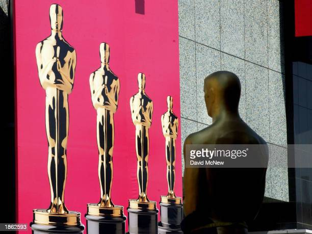 A giant Oscar statue on the red carpet faces a billboard on the Hollywood and Highland complex near the Kodak Theater home of the upcoming 75th...