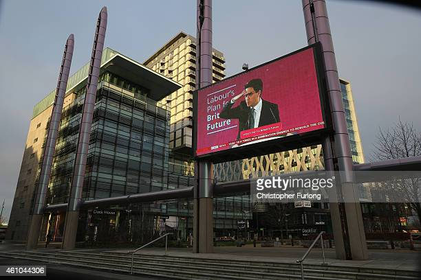 A giant outdoor television screen broadcasts Ed Miliband's image at the BBC News at Media City in Salford Quays which is home to the BBC ITV...