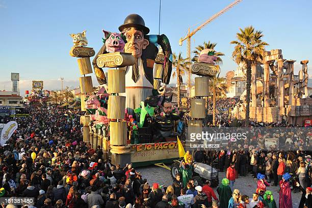A giant paper mache float moves through the streets of Viareggio during the traditional Carnival parade on February 10 2013 in Viareggio Italy The...