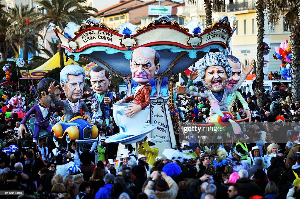 A giant paper mache float representing Italian politicians moves through the streets of Viareggio during the traditional Carnival parade on February 10, 2013 in Viareggio, Italy. The Carnival of Viareggio is considered one of the most important carnivals in Italy and is characterised by its giant paper mache floats representing caricatures of popular characters, politicians and fictional creations.