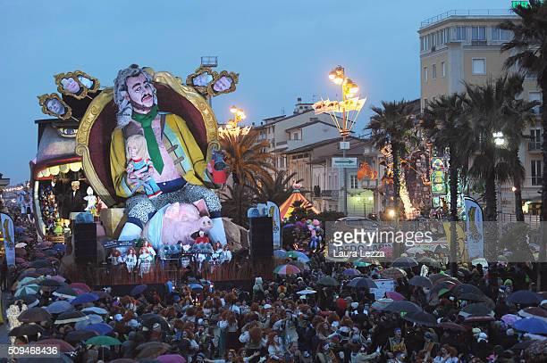 A giant papermache float representing Italian politician Matteo Salvini and French politician Marine Le Pen moves through the streets of Viareggio...