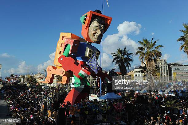 Giant papier-mache float depicting Italian Prime Minister Matteo Renzi moves through the streets of Viareggio during the traditional Carnival of...