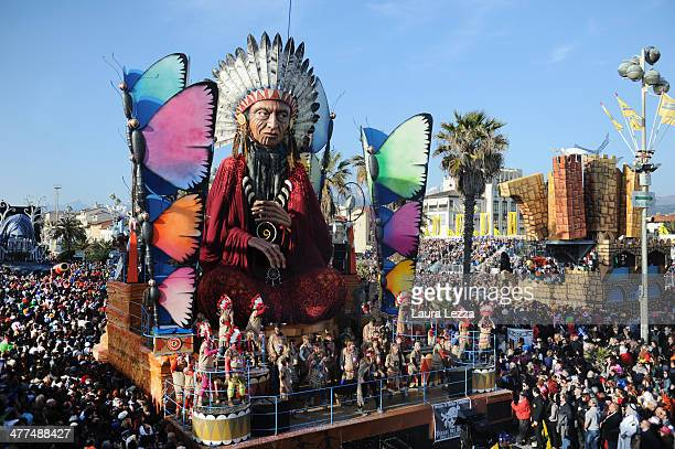A giant papiermache float representing a Native American moves through the streets of Viareggio during the traditional Carnival parade on March 9...