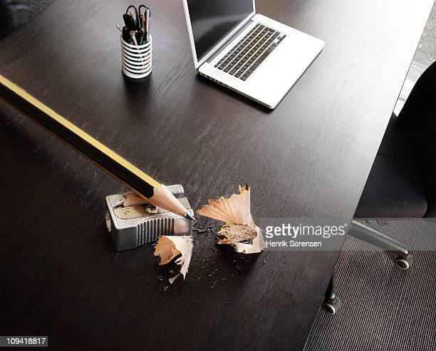 giant pencil and sharpener lying on office desk - oversized stock pictures, royalty-free photos & images