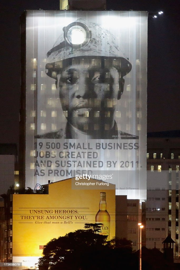 A giant photograph of a miner adorns the outside of the Anglo American Mine Company buildng on July 16, 2013 in Johannesburg, South Africa. Johannesburg became the centre of gold mining in 1886 when gold was first discovered. Two government officials were sent to establish a settlement and named it Johannesburg after the first name they both shared. The gold rush lasted for over 100 years. The South African mining industry has shed more than 340,000 jobs since 1990 but is still the fifth largest gold producer in the world and has vast amounts of other minerals still to be unearthed.