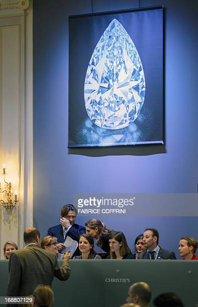 A giant picture of a pearshaped perfect D color Type IIA Flawless clarity diamond weighing 10173 carats is seen during Christie's sales on May 15...