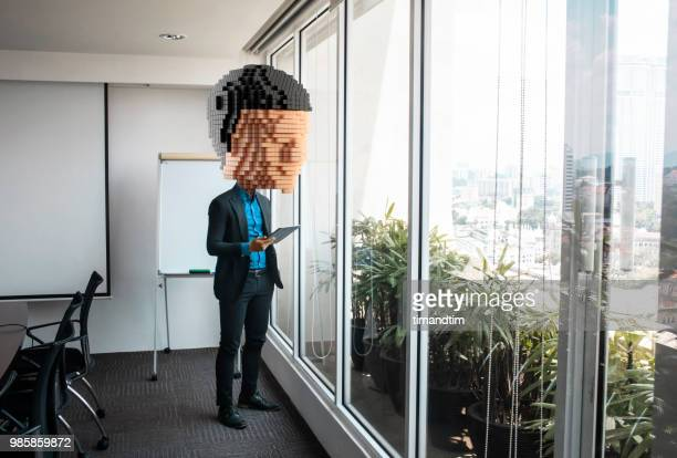Giant pixelated head of man in an office