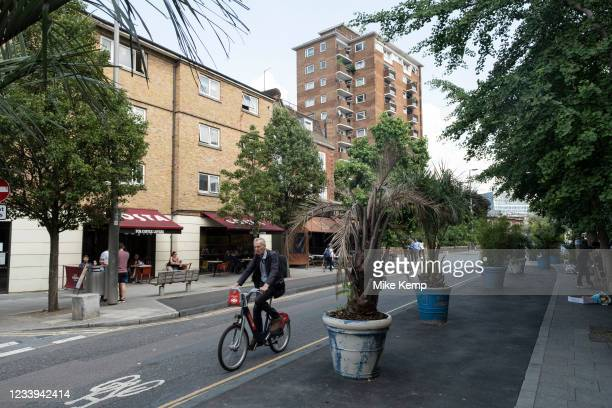 Giant plant pots containing palm trees along The Cut on 2nd July 2021 in London, United Kingdom.