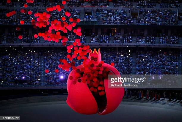 A giant Pomegranate representing abundance rebirth love and good luck splits open to release its seeds during the Opening Ceremony for the Baku 2015...