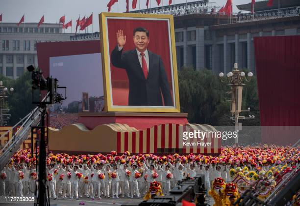 Giant portrait of Chinese President Xi Jinping is carried atop a float at a parade to celebrate the 70th Anniversary of the founding of the People's...