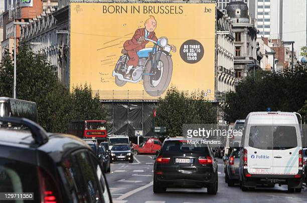 A giant poster of Tintin is displayed on the Tintin route at Place de Brouckere on October 19 2011 in Brussels Belgium