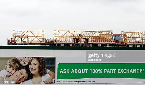 A giant poster on construction hoardings promotes partexchange deals outside a Persimmon Plc residential housing site in South Ockenden UK on Friday...