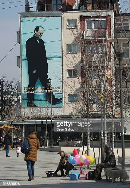 A giant poster shows Ibrahim Rugova first president of the Republic of Kosovo in the city center on March 20 2016 in Pristina Kosovo Kosovo following...