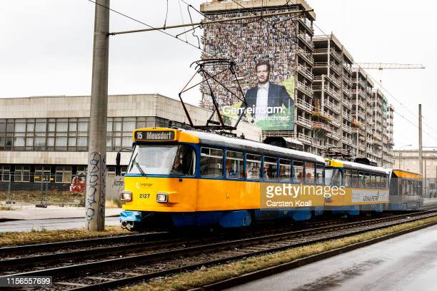 A giant poster shows the portrait of Michael Kretschmer Governor of Saxony and member of the German Christian Democrats at a building wall while...