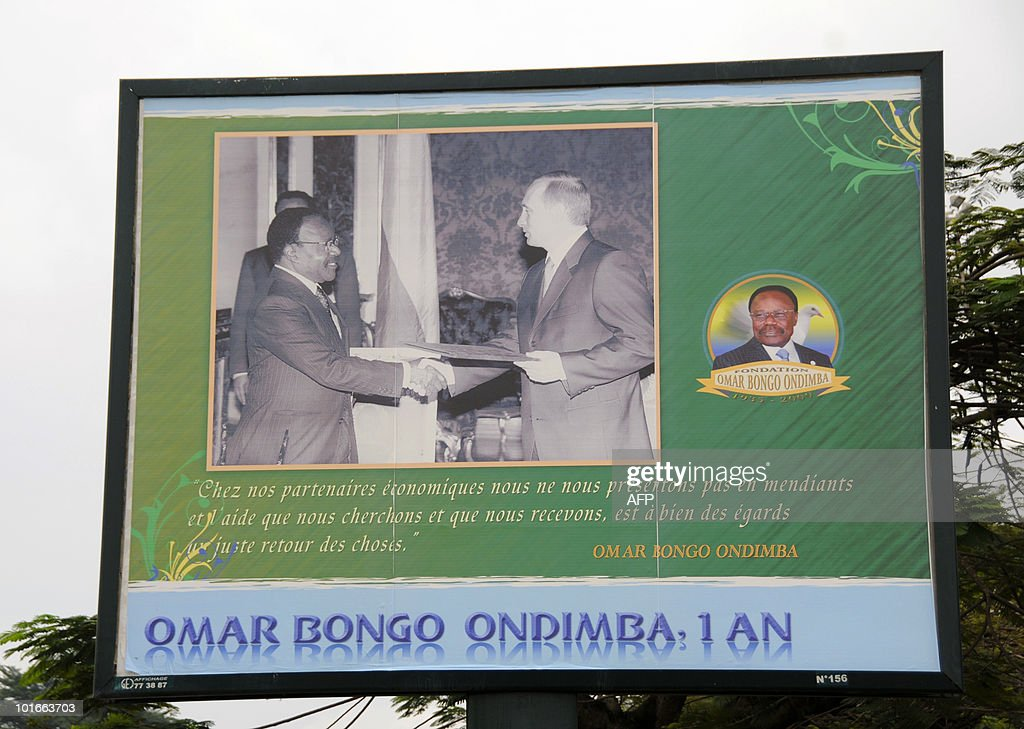 A giant poster taken on June 6, 2010 in Libreville shows Gabon's late leader Omar Bongo Ondimba (L) receiving Russian Prime Minister Vladimir Putin during a visit, ahead of the first anniversary of his death on June 8.