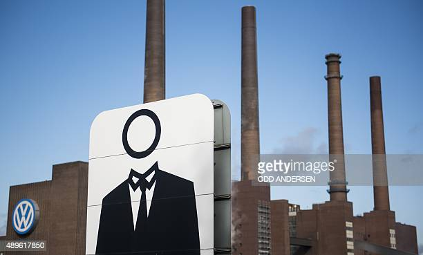 A giant poster with a faceless man is seen next to the headquarters of German car maker Volkswagen in Wolfsburg central Germany on September 23 2015...