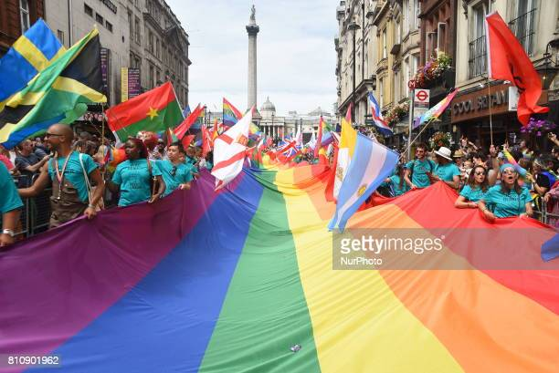 A giant rainbow flag and tens of National flags are weaved down Whitehall during the Pride in London Festival London on July 8 2017 The Pride in...
