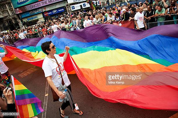 Giant rainbow flag at the Pride London gay and lesbian parade through central London Pride London aims to promote equality and diversity through all...