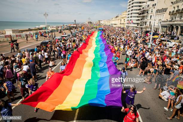 A giant rainbow Pride flag is carried along the sea front during Brighton Pride 2018 on August 4 2018 in Brighton England