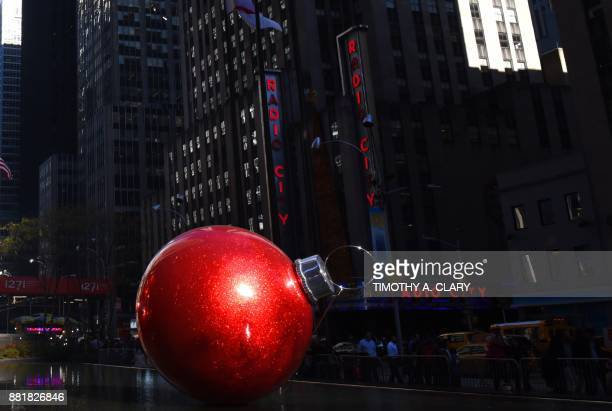 TOPSHOT A giant red ornament adorns a pool on 6th Avenue across from Radio City Music Hall on November 29 2017 in New York The Christmas season will...