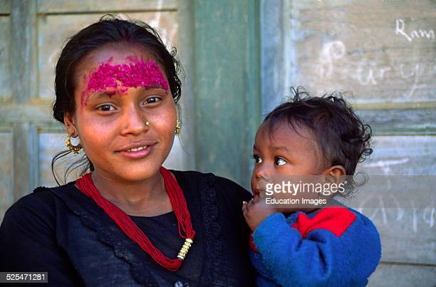 A Giant Rice Tika Beautifies This Young Mother With Child In Khandbari On Route To Makalu Nepal