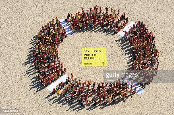 A giant ring of people from above on May 10 2010 in Sydney Australia Onlookers stared and tourists took photographs as protesters formed a giant ring...