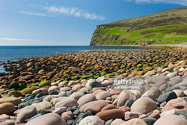 Giant rounded cobblestones lining the beach at Rackwick, Isle of Hoy, Orkney Islands, Scotland, UK