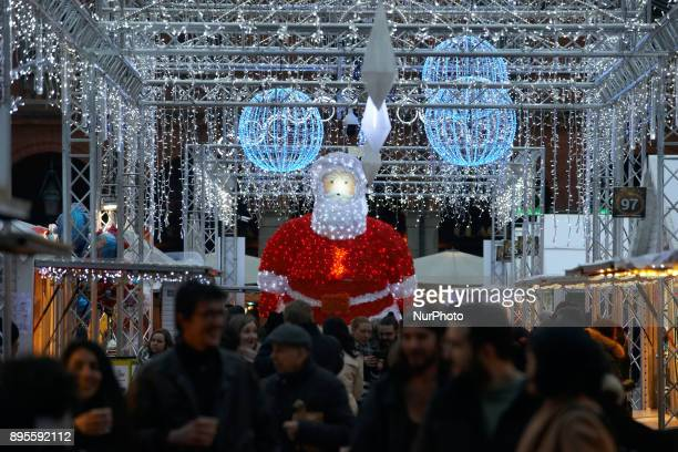 A giant Santa Claus A Christmas market is placed on the main square of Toulouse the Capitole People come to buy a hot wine or find some gifts On...