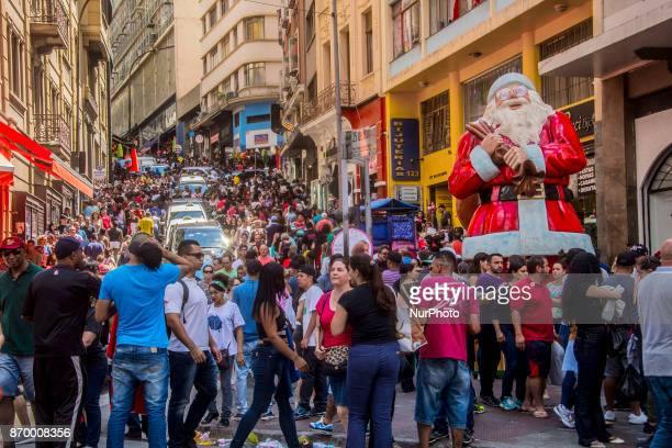 Giant Santa Claus is installed in the middle of the intersection of 25 de Março street with the slope of Porto Geral in the central region of the...