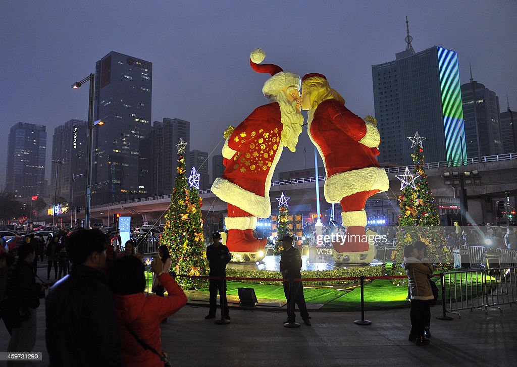 A giant Santa Claus kissing Mrs. Claus are displayed at a shopping mall on November 29, 2014 in Taiyuan, Shanxi province of China. The 8.5 meters tall giant kissing couple were displayed at a shopping mall to celebrate the upcoming Christmas.