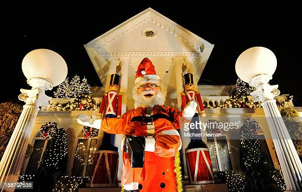 Giant Santa Claus sits in front of a decorated house on Christmas Eve December 24, 2012 in the Dyker Heights neighborhood of the Brooklyn borough of...