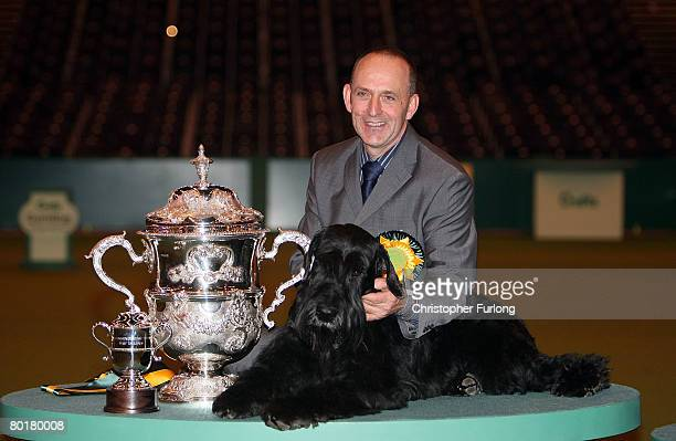 Giant Schnauzer Phillipe also know as Jafrak Phillipe Oilivier poses with his owner Kevin Cullen after winning 'Best in Show' at the 2008 Crufts dog...